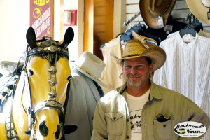 Mike trying on hats in Deadwood, SD | Photo by BackroadsVanner.com